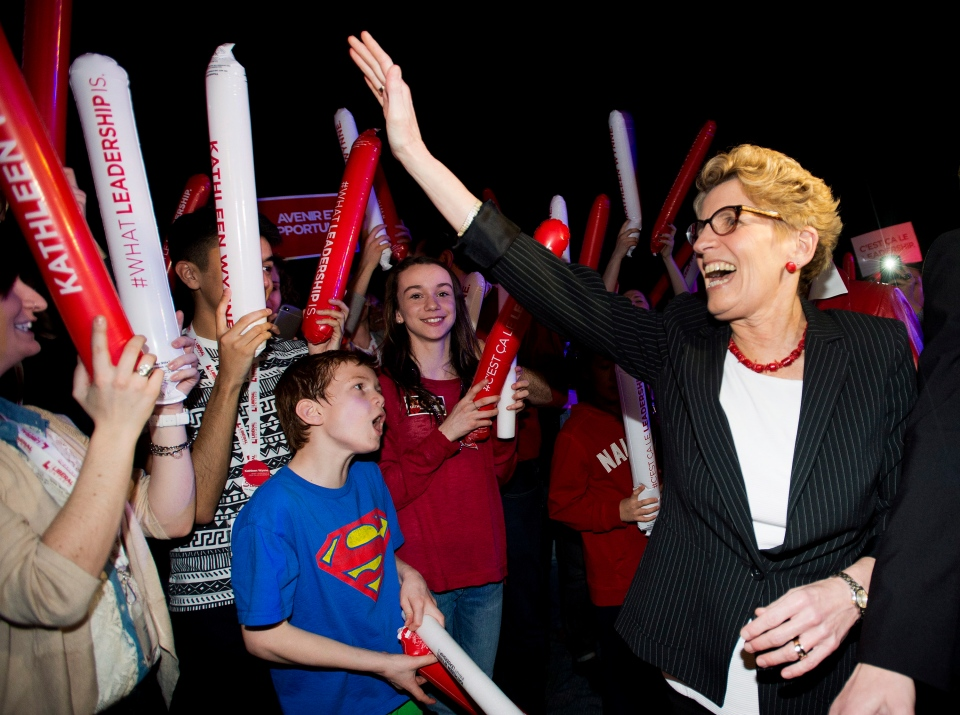 Premier Kathleen Wynne greets supporters and her caucus at a rally during the party's annual general meeting in Toronto, Saturday, March 22, 2014. (Nathan Denette / THE CANADIAN PRESS)