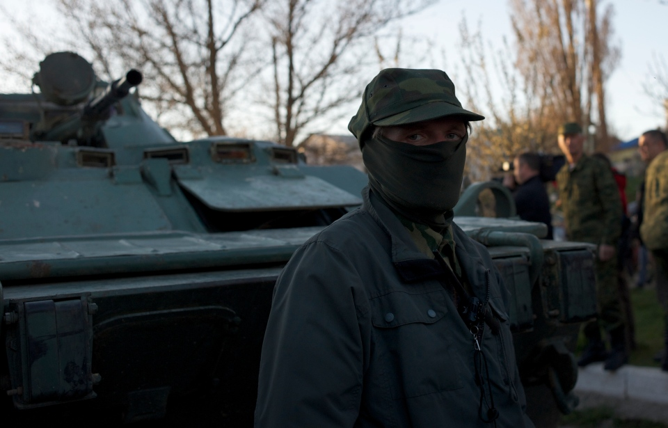 A Pro-Russian militia member guards outside the Belbek airbase after Russian troops took control over it, outside Sevastopol, Crimea, on Saturday, March 22, 2014. (AP / Andrew Lubimov)