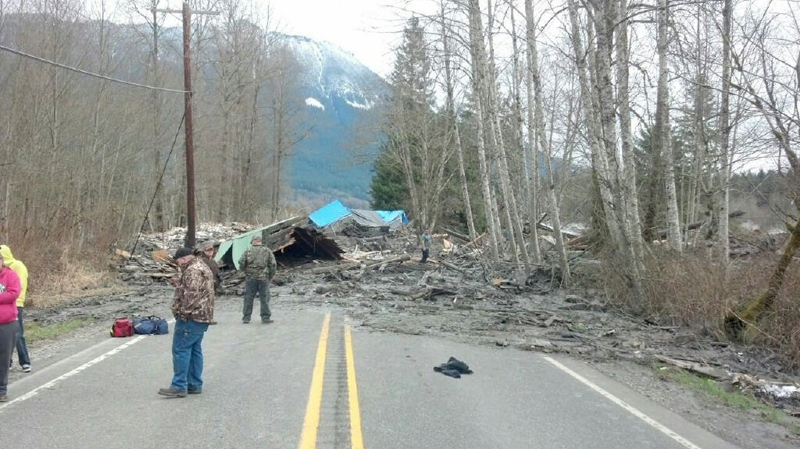This photo provided by the Washington State Patrol shows the aftermath of a mudslide that moved a house with people inside in Snohomish County on Saturday March 22, 2014. (AP Photo/Washington State Patrol)