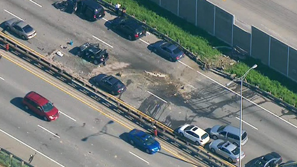 A damaged vehicle is seen on the eastbound lanes of the QEW after a a multi-vehicle collision near Hurontario Street on Friday, Oct. 7, 2011.