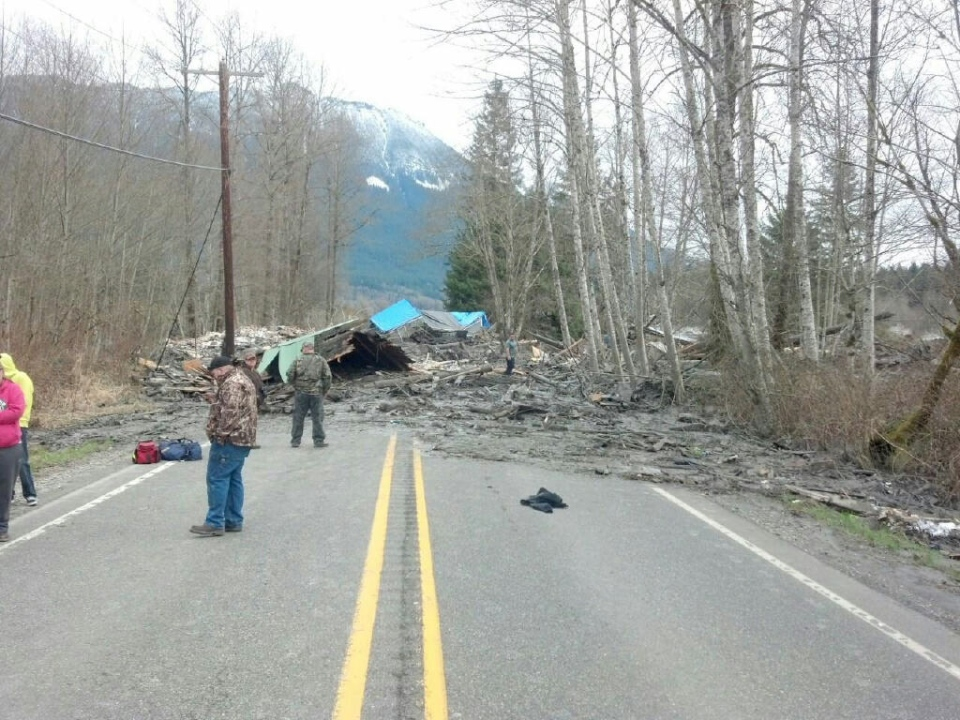 This photo provided by the Washington State Patrol shows the aftermath of a mudslide that moved a house with people inside in Snohomish County on Saturday, March 22, 2014. (AP / Washington State Patrol)