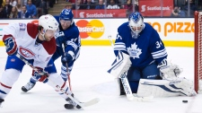 Toronto Maple goalie James Reimer, right, makes a