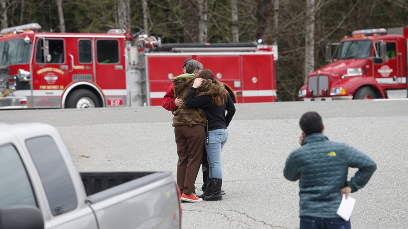 Neighbors gather at the Oso Fire Department to look for updates about the fatal mudslide that washed over homes and over Highway 530 east of Oso, Wash., Saturday, March 22, 2014. (AP)