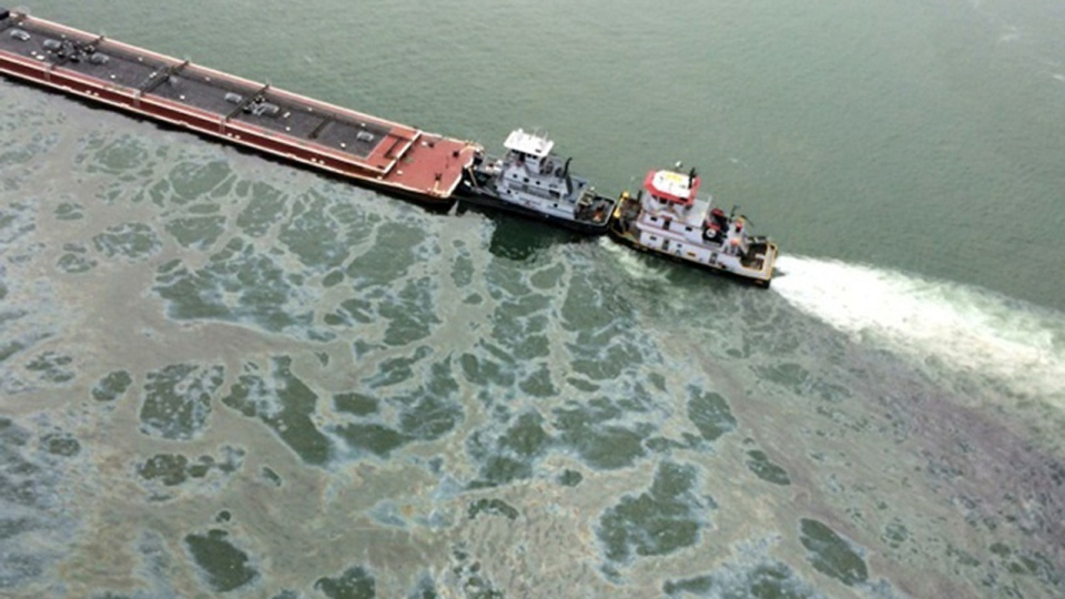 A barge loaded with marine fuel oil sits partially submerged in the Houston Ship Channel, March 22, 2014. The bulk carrier Summer Wind, reported a collision between the Summer Wind and the barge, containing 924,000 gallons of fuel oil. The barge collided with a ship in Galveston Bay on Saturday, leaking an unknown amount of the fuel into the popular bird habitat as the peak of the migratory shorebird season was approaching. (AP / U.S. Coast Guard, PO3 Manda Emery)