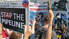 Mike Tidwell, from the Chesapeake Climate Action Network, right, addresses a rally  against the proposed Keystone XL pipeline outside the Ronald Reagan Building in Washington, Friday, Oct., 7, 2011. (AP / Pablo Martinez Monsivais)