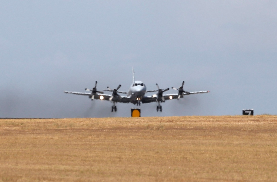 A Royal Australian Air Force AP-3C Orion takes off at RAAF Pearce Base to join the search for the missing Malaysia Airlines flight MH370 in Perth, Australia, Sunday, March 23, 2014. (AP / Rob Griffith)