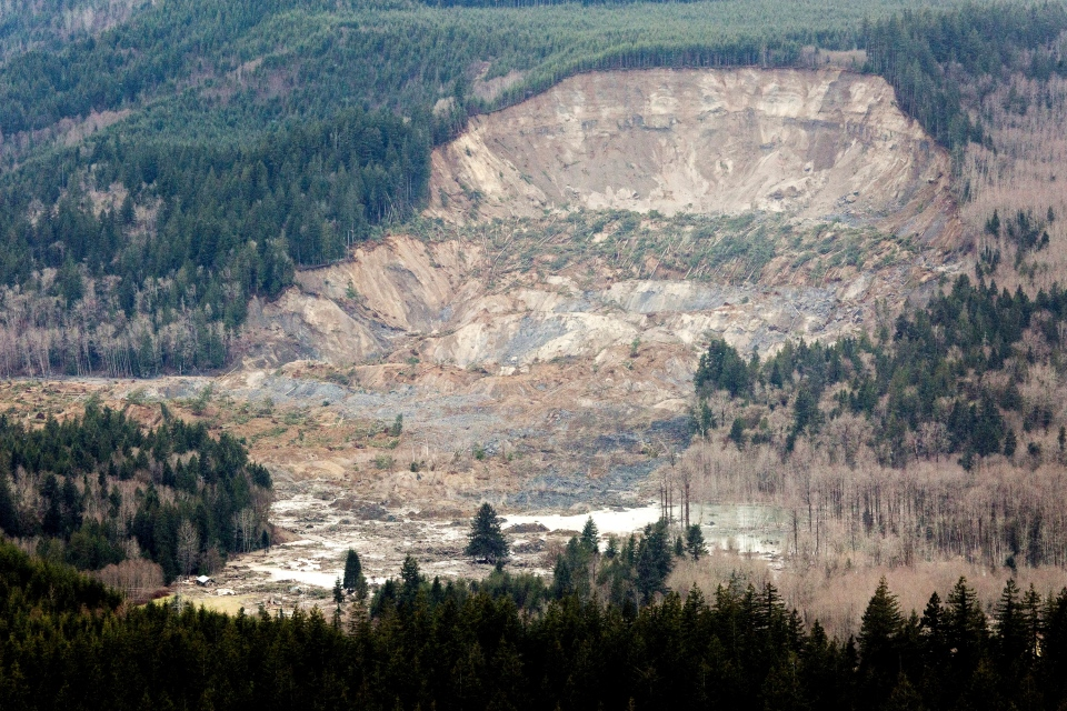 A massive mudslide is shown in between the towns of Darrington, Wash., and Arlington, Wash, Saturday, March 23, 2014. (The Seattle Times / Marcus Yam)