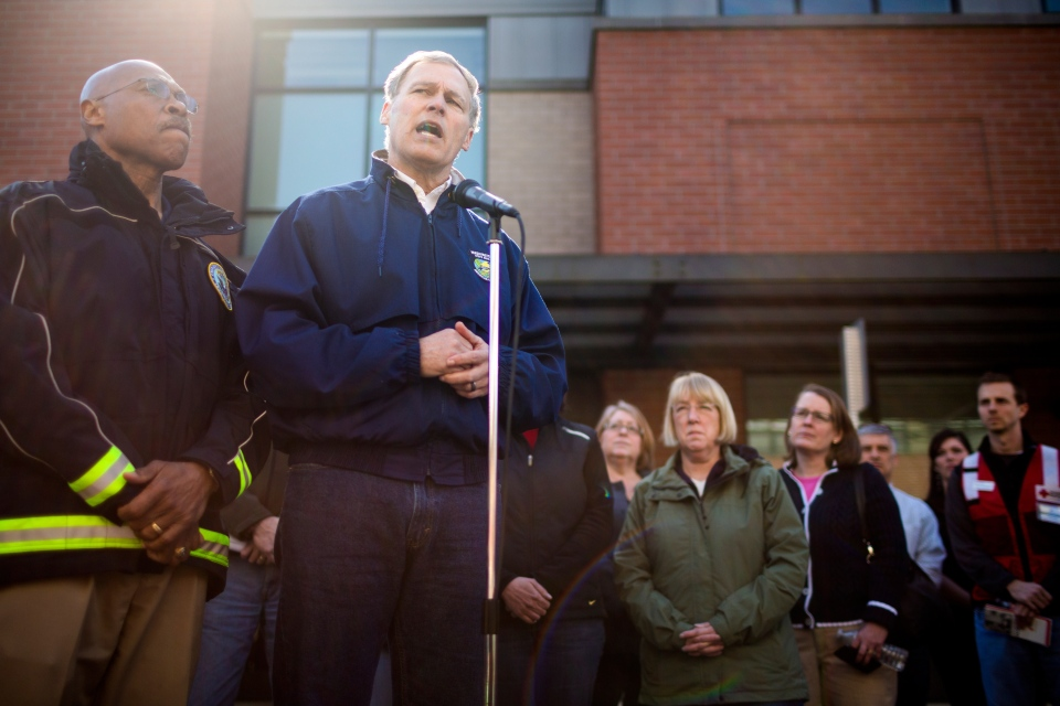 Washington Gov. Jay Inslee, second from left, addresses a crowd during a news conference outside of the Arlington Police Department, Sunday, March 23, 2014. (seattlepi.com / Jordan Stead)
