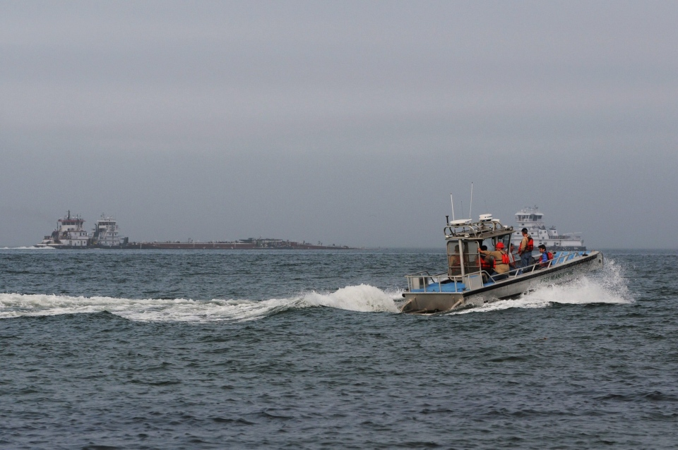 A response boat heads to the scene of a collision between a ship and barge in the ship channel near the Texas City Dike on Saturday, March 22, 2014. (The Galveston County Daily News / Neal Mora)