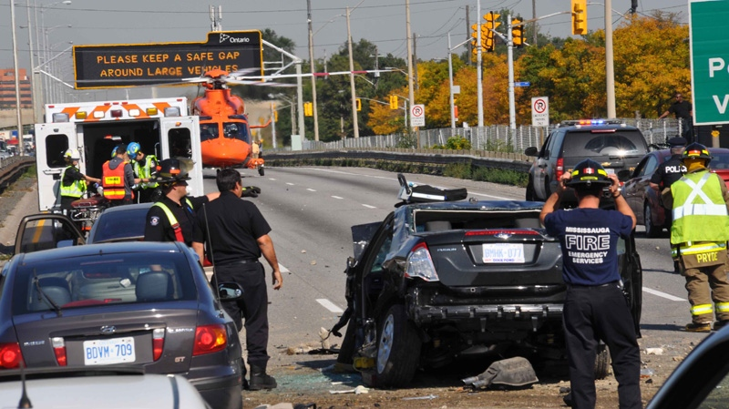 A damaged car is seen after a serious accident on the QEW on Friday, Oct. 7, 2011. (Andrew Collins for CTV News)
