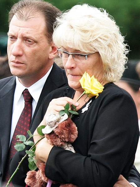 Wendy Hayward-Miskiewicz, mother of Cpl. James Arnal who was killed in Afghanistan, and his step-father Ken Miskiewicz watch as Cpl. Arnal's remains are placed in the hearse outside Grant Memorial Church after the funeral service in Winnipeg Monday, July 28, 2008. THE CANADIAN PRESS/John Woods