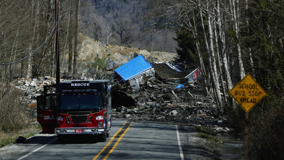 A house is seen destroyed in the mud on Highway 530 next to mile marker 37 on Sunday, March 23, 2014, the day after a giant landslide occurred near mile marker 37 near Oso, Washington. (The Seattle Times /  Lindsey Wasson)