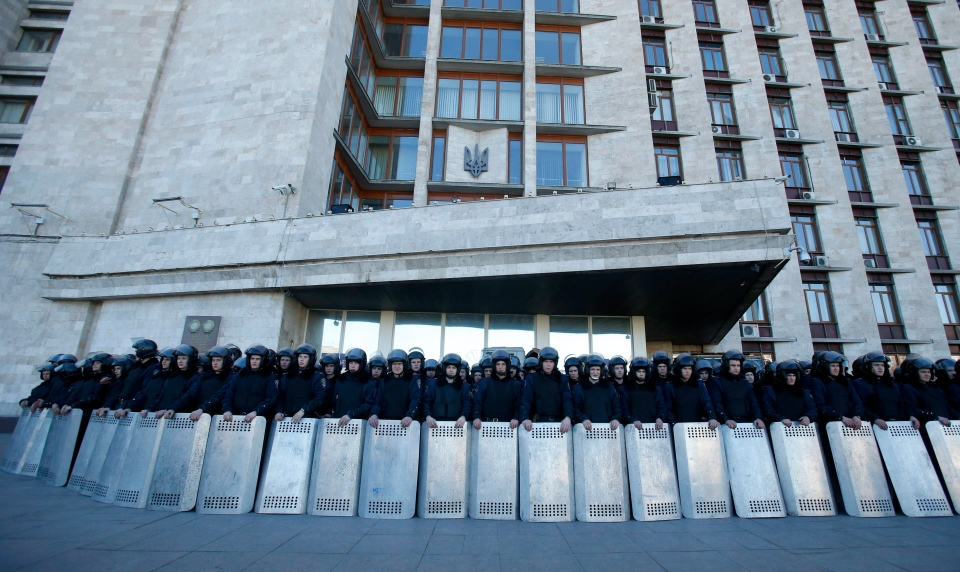 Ukrainian riot police block the entrance of the regional administrative building, during a pro Russian rally in Donetsk, eastern Ukraine on March 23, 2014. (AP / Sergei Grits)
