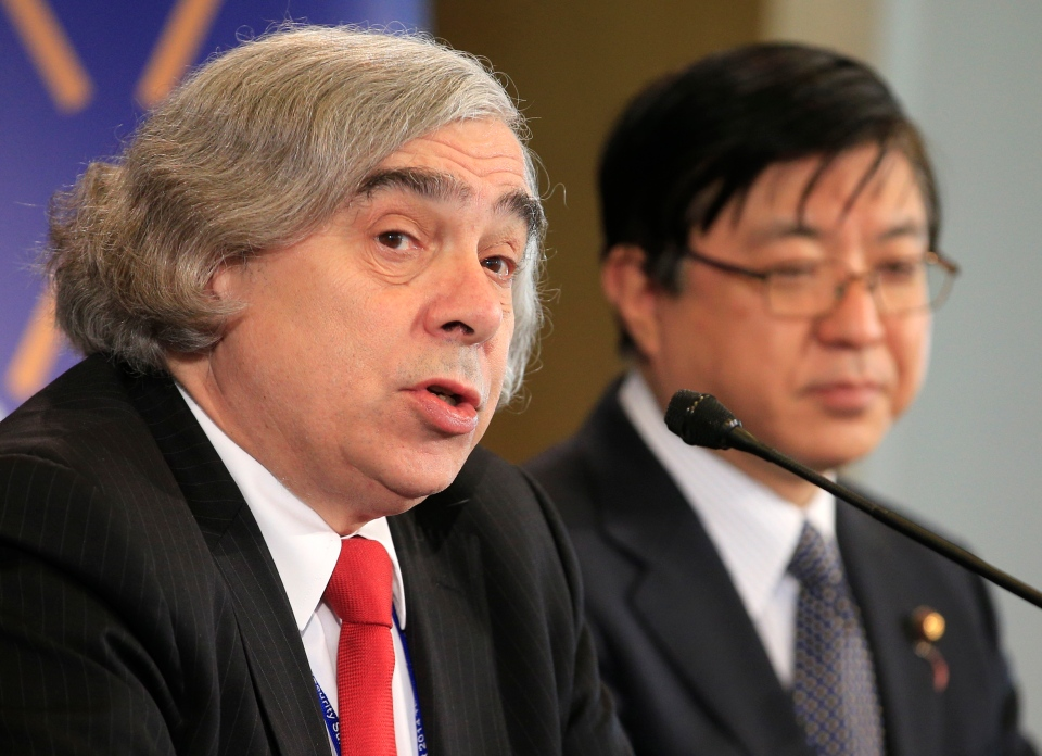 U.S. Energy Secretary Ernest Moniz, left, and Japan's Special Advisor to the Prime Minister Yosuke Isozaki, right, address the media at the first day of a two-day nuclear summit in The Hague on Monday, March 24, 2014. (AP / Yves Logghe)