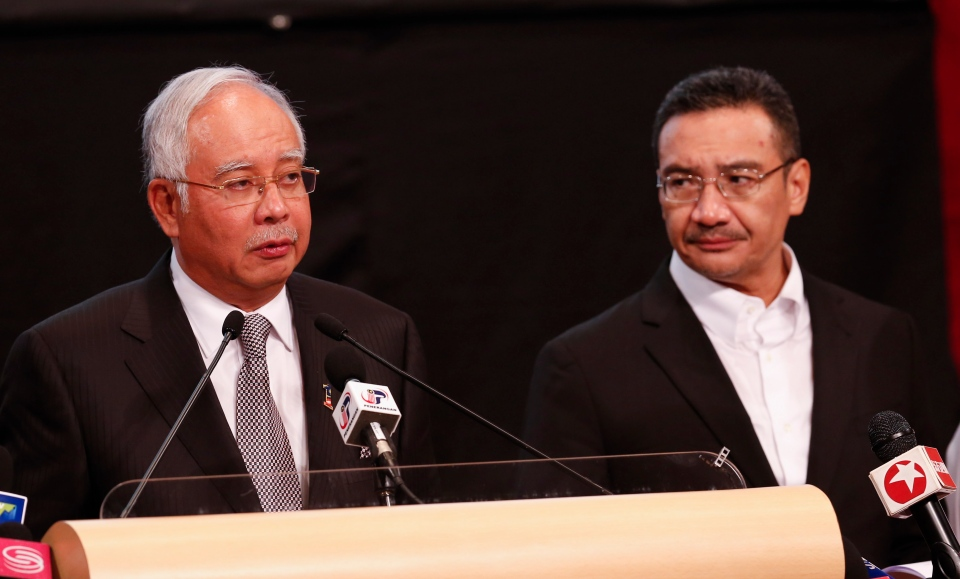 Malaysia's Prime Minister Najib Razak , left, and acting transport minister Hishammuddin Hussein speak during the press conference for the missing Malaysia Airlines jet, MH370, at Putra World Trade Centre PWTC in Kuala Lumpur, Malaysia, Monday, March 24, 2014. (AP / Vincent Thian)