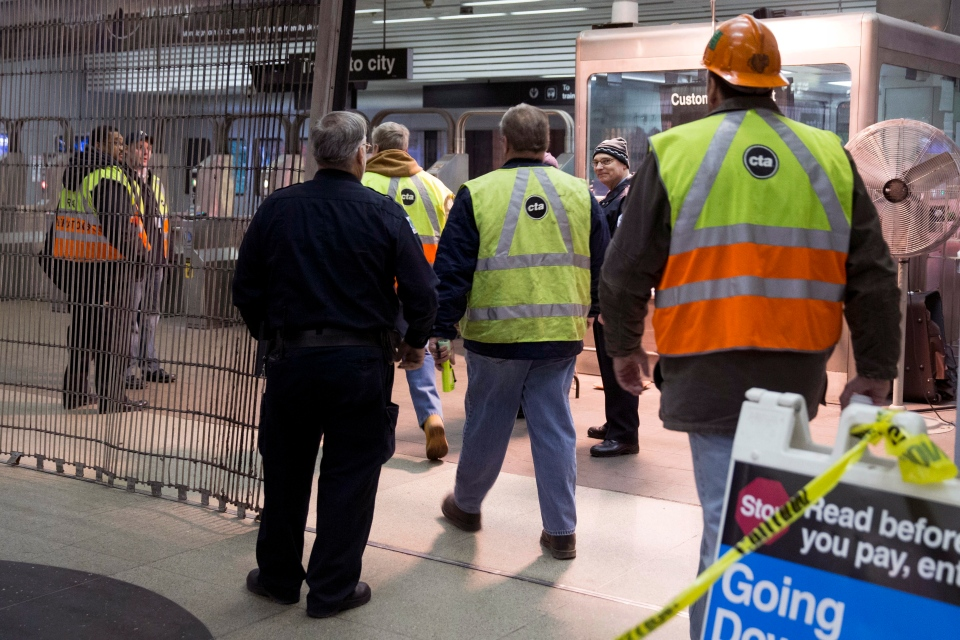 Chicago Transit Authority employees work the scene where a Chicago Transit Authority derailed at the O'Hare Airport station early Monday, March 24, 2014. (AP / Andrew A. Nelles)