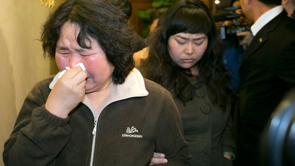 Relatives of Chinese passengers aboard the Malaysia Airlines jet, MH370, grieve after being told of the latest news in Beijing, China, Monday, March 24, 2014. (AP / Ng Han Guan)