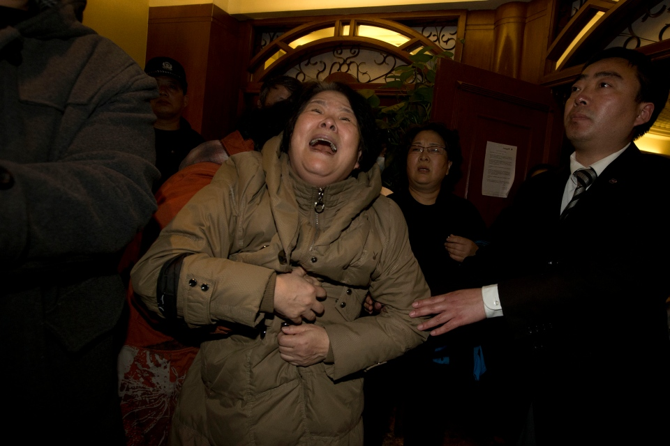 A relative of one of the Chinese passengers aboard the Malaysia Airlines jet, MH370 grieves after being told of the latest news in Beijing, China, Monday, March 24, 2014. (AP / Ng Han Guan)