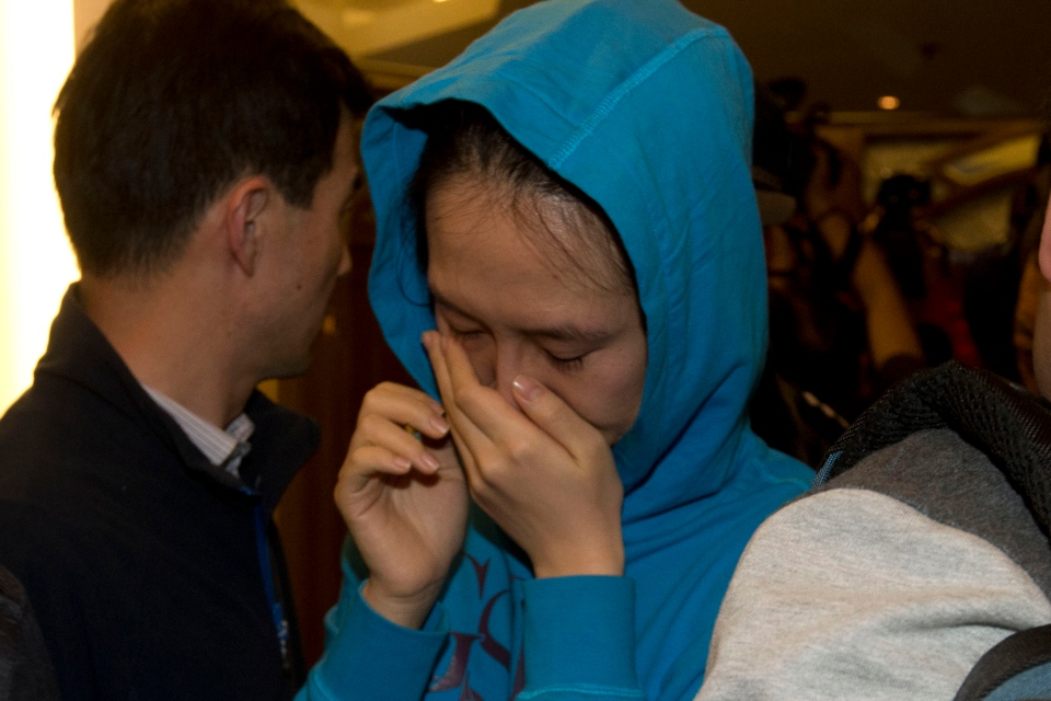 A relative of a Chinese passenger aboard the Malaysia Airlines MH370, cries after being told the latest update in Beijing, China, Monday, March 24, 2014. (AP / Ng Han Guan)