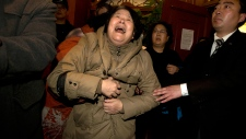 Latest on Flight 370 relative mourns in Beijing