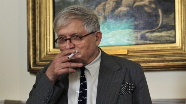 British artist David Hockney poses for photographers during a press launch for an upcoming exhibition, entitled 'David Hockney: A Bigger Picture' by the Royal Academy of Arts, in central London, Wednesday, Sept. 7, 2011.