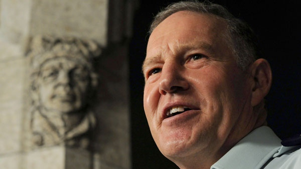 Chief of Defence Staff General Walter Natynczyk speaks to reporters in the foyer of the House of Commons on Parliament Hill in Ottawa, on Monday, September 19, 2011. (Sean Kilpatrick / THE CANADIAN PRESS)