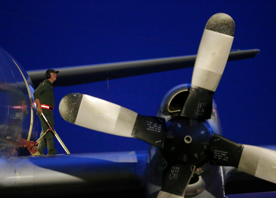 A crew member steps off a Royal Australian Air Force AP-3C Orion upon its return from a search for the missing Malaysia Airlines flight MH370 over the Indian Ocean, at the Royal Australian Air Force base Pearce in Perth, Monday, March 24, 2014. (AP / Jason Reed)