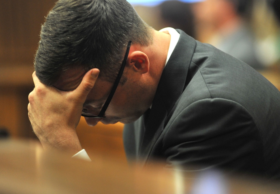 Oscar Pistorius holds his head in his hands as he listens to evidence being given in court in Pretoria, South Africa, Monday, March 24, 2014. (AP / Ihsaan Haffejee)