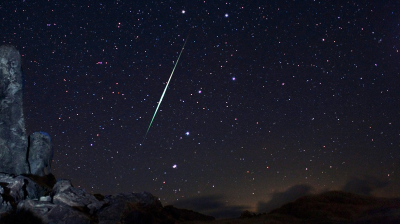 A meteor explodes across night sky in this undated file photo.