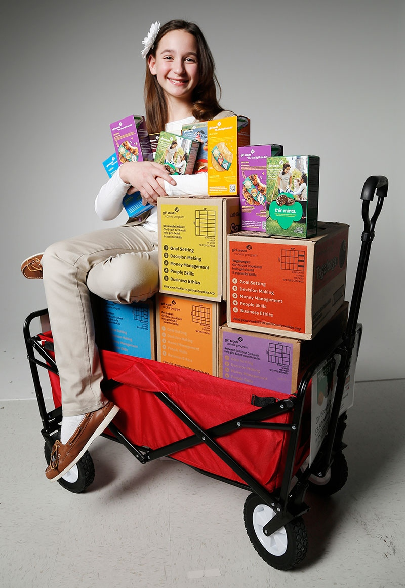 This Feb. 3, 2014 photo shows Katie Francis, 11, posing for a photo in Oklahoma City. Francis says she asks everyone she meets to buy Girl Scout cookies and has broken the organization's decades-old sales record by a margin about the size of a Thin Mint. Francis sold 18,107 boxes in the seven-week sales period that ended Sunday, March 23, 2014. The previous mark was set by Elizabeth Brinton, who sold approximately 18,000 one year in the 1980s. (AP / The Oklahoman, Doug Hoke)