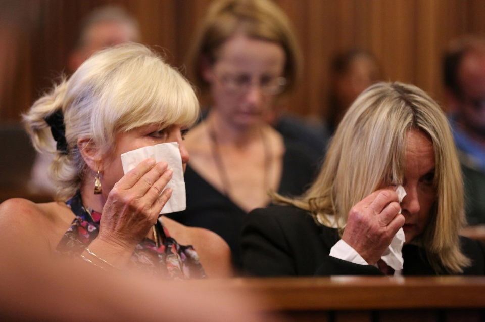 June Steenkamp, right, mother of the late Reeva Steenkamp, and family friend, Jenny Strydom, left, react during the murder trial of Oscar Pistorius, during cross questioning on mobile phone text messages between Pistorius and Steenkamp, in court in Pretoria, South Africa, Tuesday, March 25, 2014. (AP / Siphiwe Sibeko)