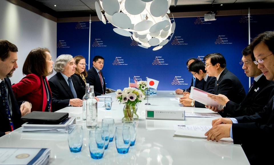 U.S. Energy Secretary Ernest Moniz, third left, and Japan's Special Advisor to the Prime Minister Yosuke Isozaki, third right, talk at a bilateral meeting on the last day of the Nuclear Security Summit (NSS) in The Hague, Netherlands on March 25, 2014. (AP / Koen van Weel)