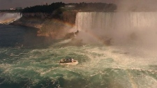 A Maid of the Mist tourboat takes sightseers to the base of Horseshoe Falls, right, after sailing up the Niagara River past the American Falls, left, in this Aug. 28, 1997 photo at Niagara Falls, N.Y.