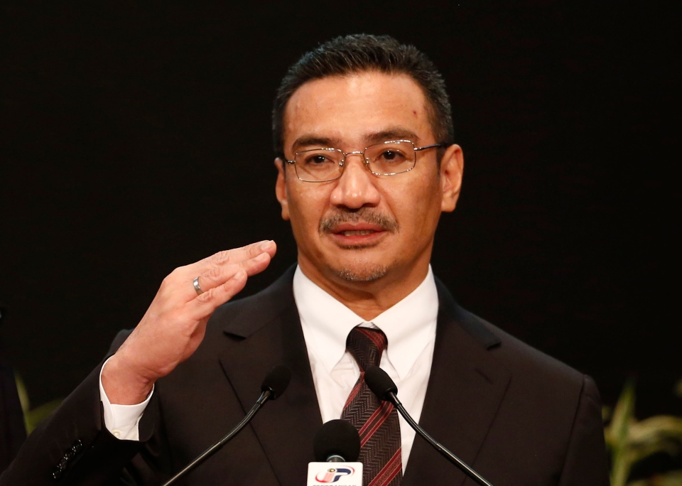Malaysia's acting Transport Minister Hishammuddin Hussein answers a reporter's questions during a press conference for the missing Malaysia Airline, flight MH370, at Putra World Trade Centre (PWTC) in Kuala Lumpur, Malaysia, Tuesday, March 25, 2014.  (AP / Vincent Thian)