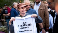 "Cate Nolan, from Brooklyn, New York, holds up a shirt that says ""I Am A Revolting Citizen"" while participating in the ""Occupy Wall Street"" protests in Zuccotti Park, in New York, on Friday, Oct. 7, 2011. (AP / Andrew Burton)"