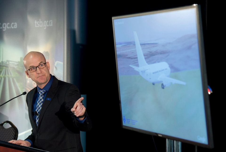 Transportation Safety Board Investigator-in-Charge Brian MacDonald points to a simulation showing the final minutes of First Air flight 6560, Tuesday, March 25, 2014. (Adrian Wyld / THE CANADIAN PRESS)