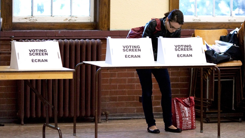 A woman casts her ballot at a voting station in Toronto as voters participate in the Ontario Provincial Election on Thursday, Oct. 6, 2011. (Chris Young / THE CANADIAN PRESS)