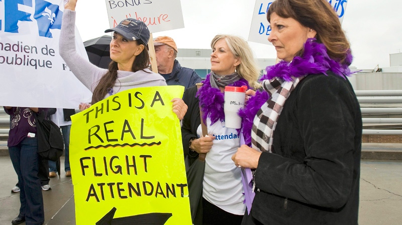 Air Canada employees hold a rally at Pierre Elliott Trudeau airport in Montreal, Tuesday, Sept., 20, 2011. (Graham Hughes / THE CANADIAN PRESS)