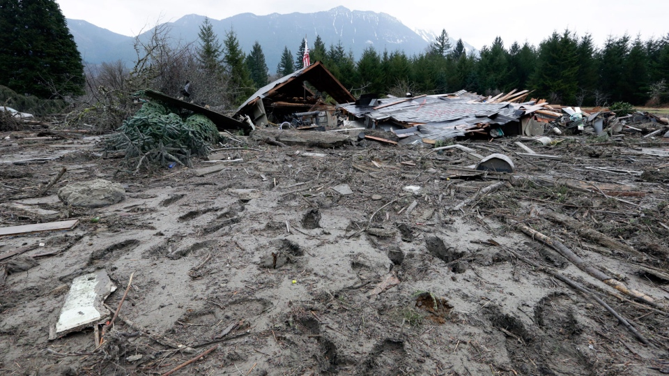 Footprints from searchers remain in mud at the edge of a deadly mudslide Tuesday, March 25, 2014, in Oso, Wash. (AP / Elaine Thompson)