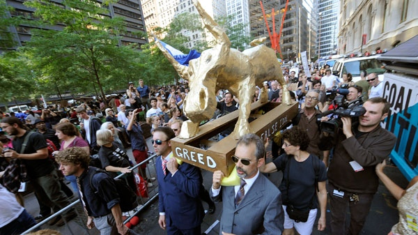 "A coalition of clergy carried a ""False Idol"" to the Occupy Wall Street encampment in Zuccotti Park in New York, Sunday, Oct. 9, 2011. (AP / Henny Ray Abrams)"