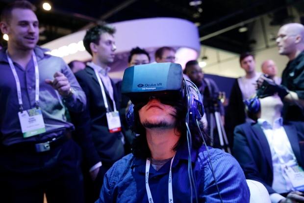 Man plays video game wearing Oculus Rift