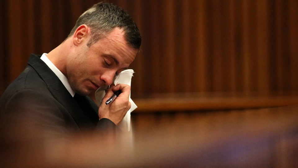 Oscar Pistorius reacts in the dock during cross questioning on mobile phone text messages between him and Reeva Steenkamp in court in Pretoria, South Africa, Tuesday, March 25, 2014. (AP / Siphiwe Sibeko)