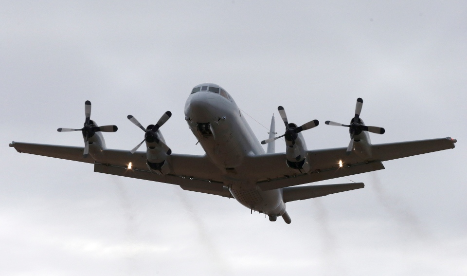 A Royal Australia Air Force AP-3C Orion takes off from RAAF Base Pearce in Perth, Australia to resume the search for missing Malaysia Airlines Flight MH370 in the southern Indian Ocean, Wednesday, March 26, 2014. (AP / Rob Griffith)