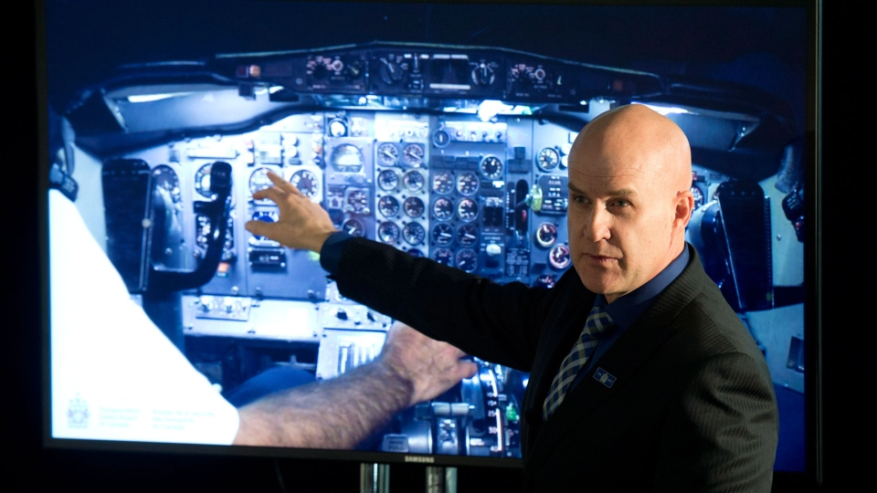 Transportation Safety Board Invesitgator-in-Charge Brian MacDonald speaks about the findings of a report into the First Air plane, which crashed in Resolute in 2011, during a news conference Tuesday March 25, 2014 in Ottawa. (Adrian Wyld / THE CANADIAN PRESS)