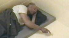 Robert Pickton is shown in his cell in this still image taken from video released by BC Courts. The mammoth investigation and mega multiple trials that ultimately convicted serial killer Robert Pickton cost the British Columbia government more than $102 million.