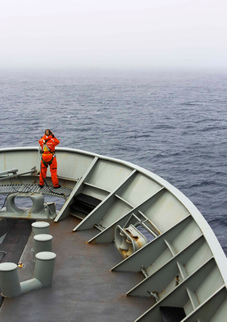 A lookout is stationed on bow of HMAS Success during the search in the southern Indian Ocean for signs of the missing Malaysia Airlines Flight MH370. (Australian Department of Defence / James Whittle)