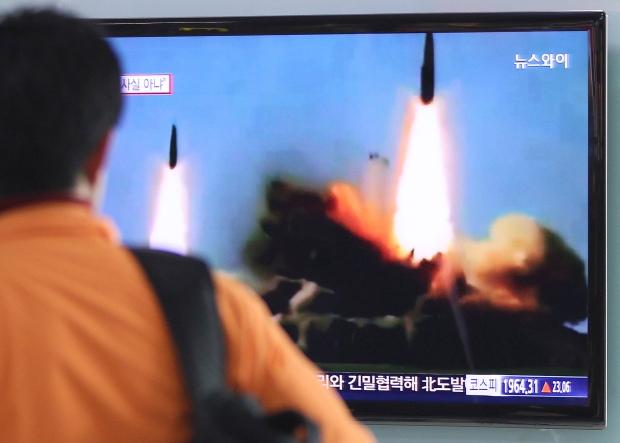 North Korea fires 2 missiles as rivals meet