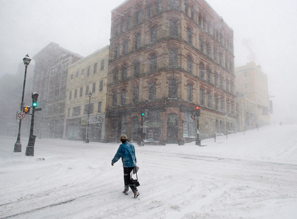 A person walks through a spring snow storm in Halifax, Wednesday, March 26, 2014. (Andrew Vaughan / THE CANADIAN PRESS)