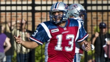 Montreal Alouettes quarterback Anthony Calvillo celebrates after completing a pass to Jamel Richardson become the CFL's all-time leading passer against the Toronto Argonauts during third quarter CFL football action Monday, October 10, 2011 in Montreal. THE CANADIAN PRESS/Paul Chiasson