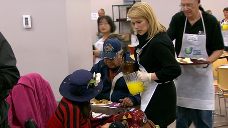 The Union Gospel Mission served up a Thanksgiving feast to a record number of people Monday, thanks to the help of volunteers, including CTV's Tamara Taggart, seen here. Oct. 10, 2011. (CTV)